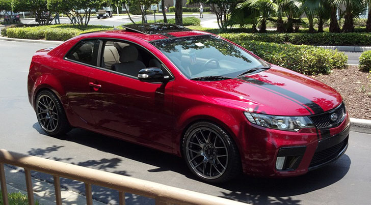 Spicy Red Kia Forte Koup EX With Dual Exhaust