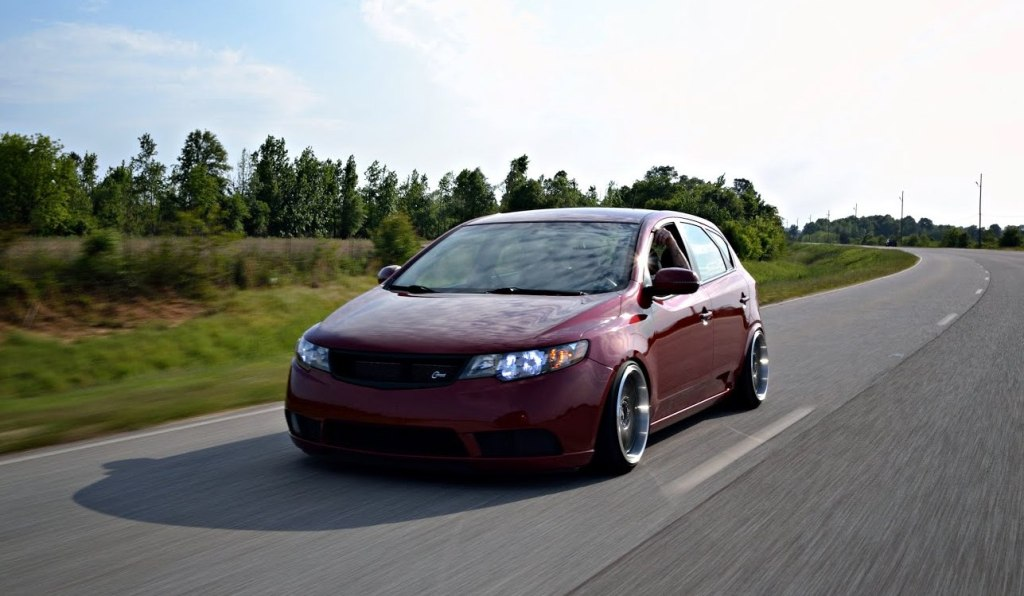 Spicy Red Kia Forte 5 With C Mod Grille Rear Camber Shims