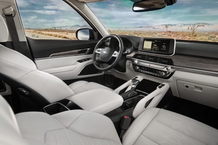 Kia Telluride SUV looks beautiful inside. The Nappa leather in white colors and wood trim look superb.